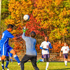 Leominster's Noel Rymbai charges the net as North Middlesex goalkeeper Collin Anselmi makes the save. Nashoba Valley Voice/Ed Niser