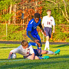 North Middlesex senior defender Nate Messina slide tackles Leominster's Gene Nartey. Nashoba Valley Voice/Ed Niser
