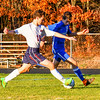 North Middlesex senior defender Ethan Neilan tackles Leominster's Andrew Sanchez. Nashoba Valley Voice/Ed Niser