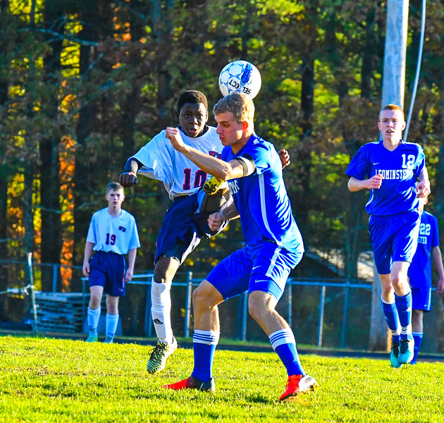 North Middlesex striker Roody Clemetson lifts a ball during Tuesday's 2-1 loss to Leominster. Nashoba Valley Voice/Ed Niser