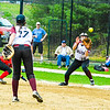 Groton-Dunstable first baseman Helen Kilian fires to second baseman Laura Bieren to complete a double play.<br /> Nashoba Valley Voice/Ed Niser