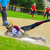 Groton-Dunstable's Whitney Ellis dives into third during Friday afternoon's loss to Hudson. Nashoba Valley Voice/Ed Niser