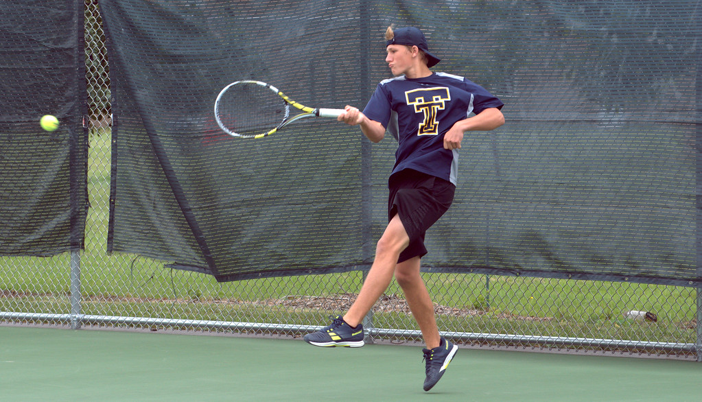 . Trenton�s No. 1 singles player Joey Cormier competes in Saturday\'s Grosse Ile Invitational. Cormier and the Trojans went on to earn a third-place finish in the tournament. Frank Wladyslawski - Digital First Media