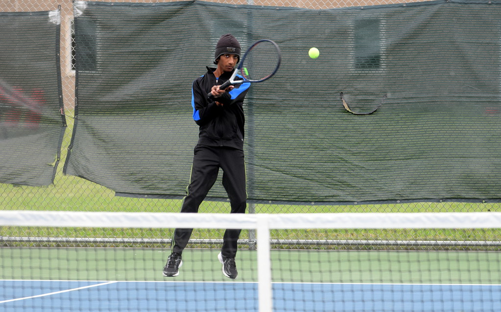 . Gibraltar Carlson�s No. 1 singles player Arun Jayaraman returns the ball during a match at Saturday\'s Grosse Ile Invitational. Jayaraman and the Marauders finished in second place for the day. Frank Wladyslawski - Digital First Media