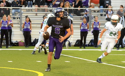 Woodhaven quarterback Josh Watters looks for an open receiver during Friday night's battle with Allen Park. The host Warriors ultimately fell by a score of 21-7 and slipped into a first-place tie in the Downriver League with the Jaguars, Gibraltar Carlson and Trenton. Frank Wladyslawski - Digital First Media