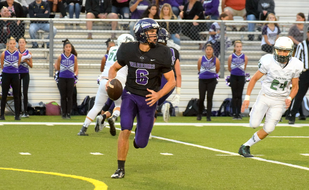 . Woodhaven quarterback Josh Watters looks for an open receiver during Friday night\'s battle with Allen Park. The host Warriors ultimately fell by a score of 21-7 and slipped into a first-place tie in the Downriver League with the Jaguars, Gibraltar Carlson and Trenton. Frank Wladyslawski - Digital First Media