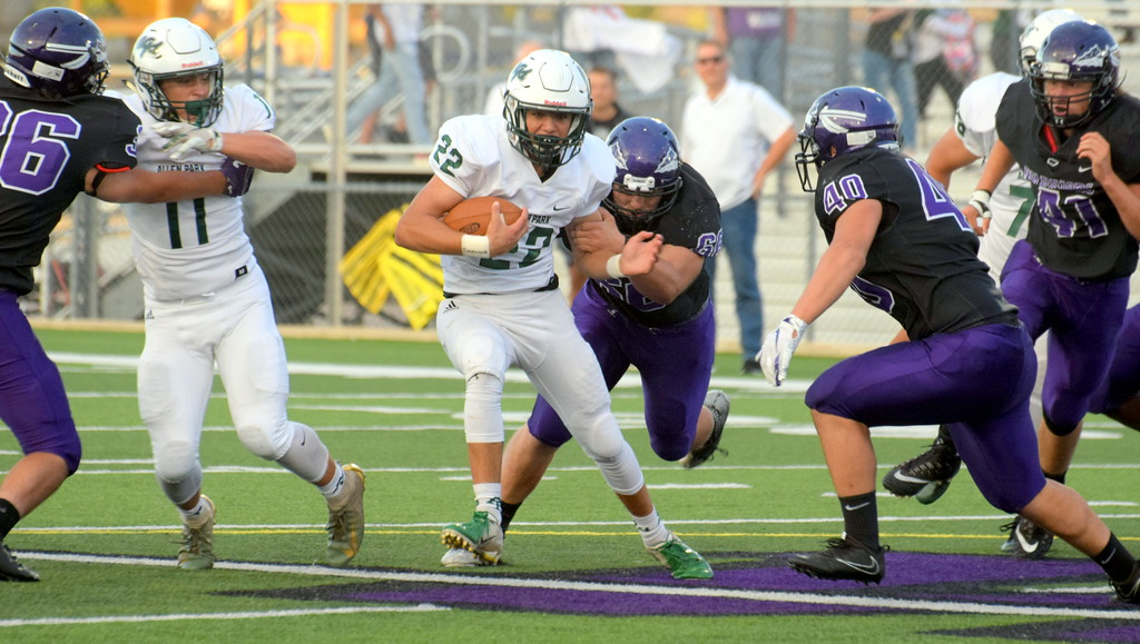 . Allen Park\'s Jakob Marsee (22) carries the ball on Friday night at Woodhaven and gets a block from Nico Tiberia (11). The visiting Jaguars came away with a 21-7 victory and pulled into a first-place tie in the Downriver League with the Warriors, Gibraltar Carlson and Trenton. Frank Wladyslawski - Digital First Media