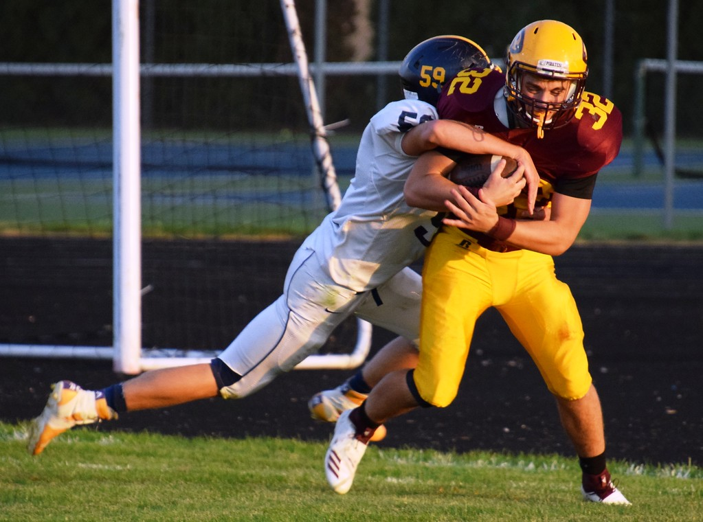 . Riverview\'s Steven Rice (32) scored a touchdown on Friday night against visiting Carleton Airport and helped guide the Pirates to a 20-9 victory in the Huron League meeting. Alex Muller - Digital First Media