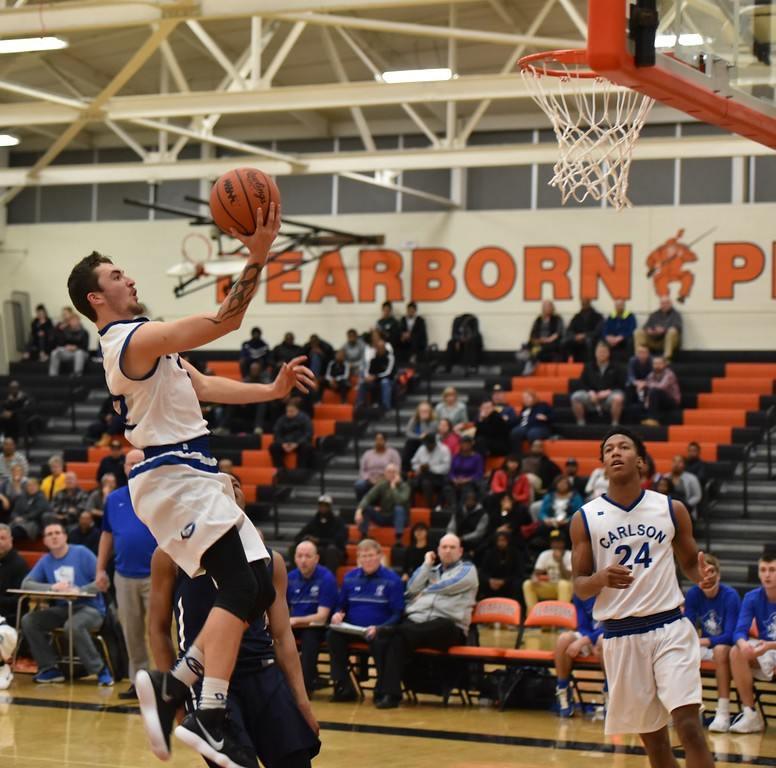 . Gibraltar Carlson took on Wayne Memorial on Monday night in the Class A,  Region 7 semifinals at Dearborn High. The Marauders ultimately fell by a score of 65-46. Photo by Alex Franzen - For The News-Herald