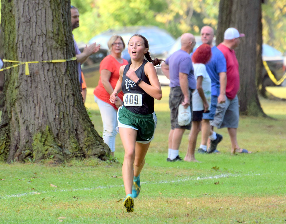 . Allen Park\'s Lisa Luecke nears the finish line during Tuesday\'s Downriver League Jamboree at Elizabeth Park in Trenton. Luecke finished on top on the girls\' side, which helped guide the Jaguars to a first-place finish as a team. Frank Wladyslawski - Digital First Media