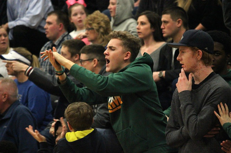 Flat Rock defeated Dundee by a score of 56-48 on Monday night in a Class B regional semifinal at Carleton Airport. The Rams moved on to face Divine Child on Wednesday for the title. Photo by Ricky Lindsay - For The News-Herald
