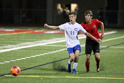 Gibraltar Carlson's Aidan Ostrowski (11) and Divine Child's Nate Elliott chase after the ball on Thursday night. The visiting Marauders ultimately suffered 6-2 defeat in the non-conference battle. Ryan Dickey - For Digital First Media