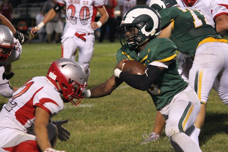 Grosse Ile headed to Flat Rock on Friday night and defeated the Rams by a score of 33-28.  Ricky Lindsay - For Digital First Media