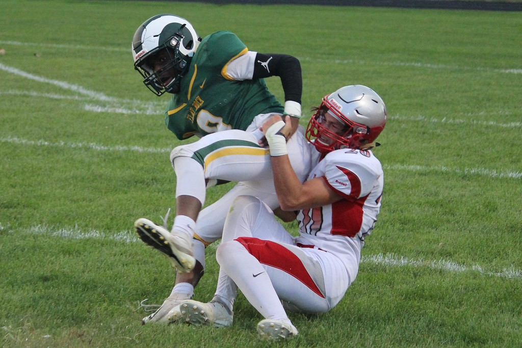 . Grosse Ile headed to Flat Rock on Friday night and defeated the Rams by a score of 33-28.  Ricky Lindsay - For Digital First Media