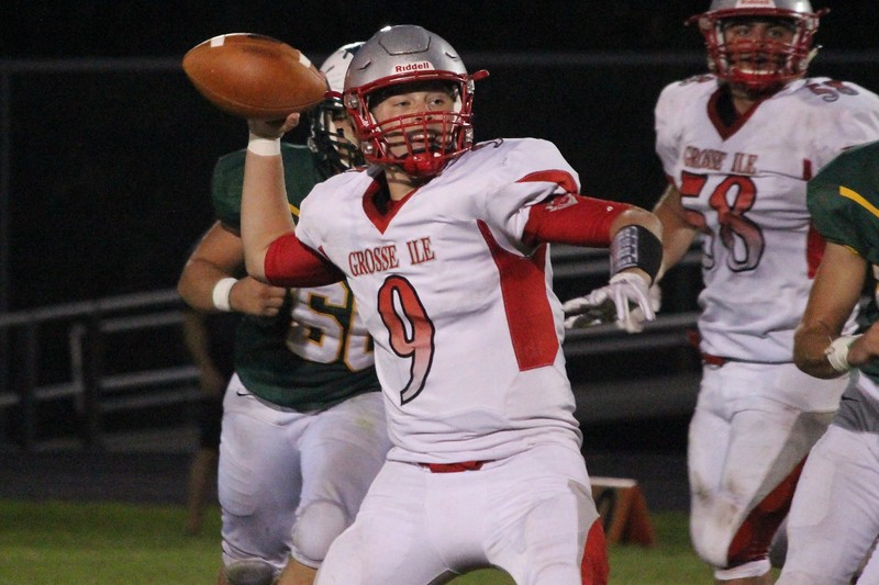 Grosse Ile quarterback Zak Thompson gets ready to throw during his team's 33-28 victory at Flat Rock on Friday night. Thompson threw for 254 yards and three touchdowns and also ran for a score. Ricky Lindsay - For Digital First Media