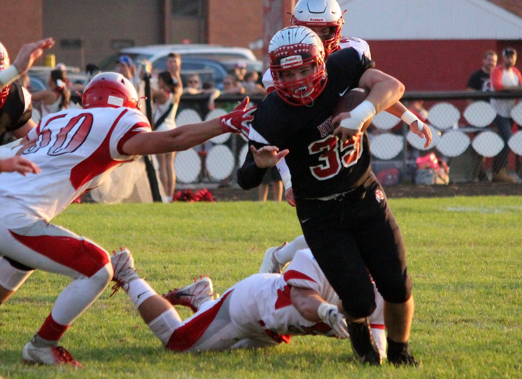 . Troy Blosser of New Boston Huron carries the ball during his team\'s Huron League battle with visiting Grosse Ile on Friday night. The Chiefs ultimately fell by a score of 35-7. Ricky Lindsay - For Digital First Media
