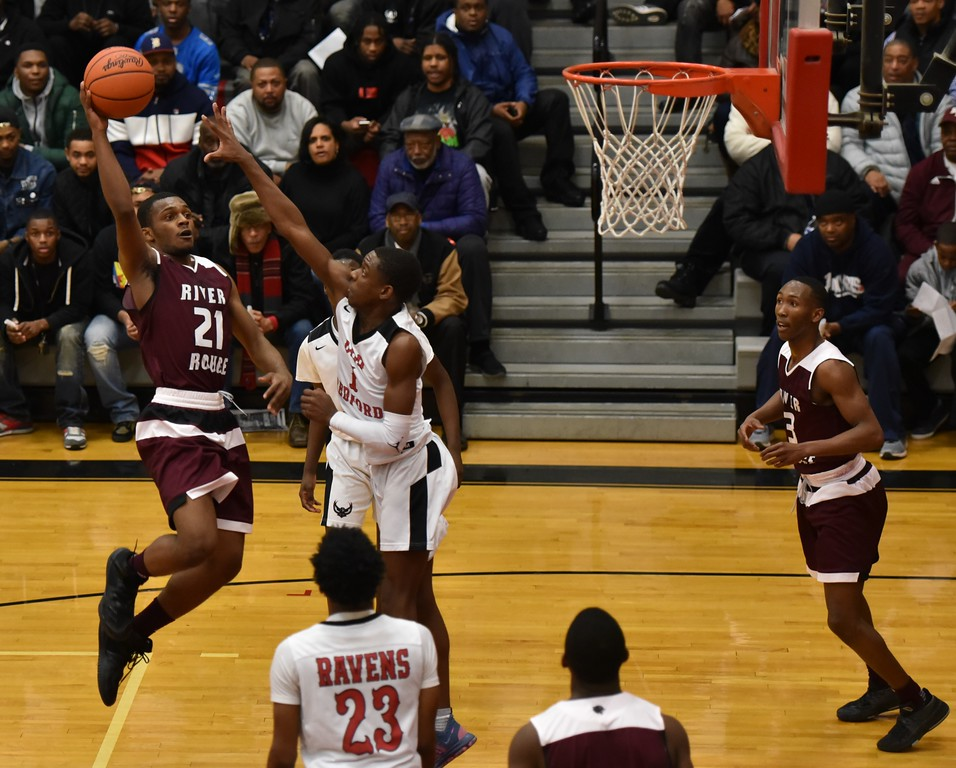 . River Rouge defeated Detroit Old Redford by a score of 50-43 on Wednesday night in the Class B, Region 12  championship game at Livonia Clarenceville. It marked the Panthers\' third consecutive regional title. Photo by Alex Franzen - For The News-Herald