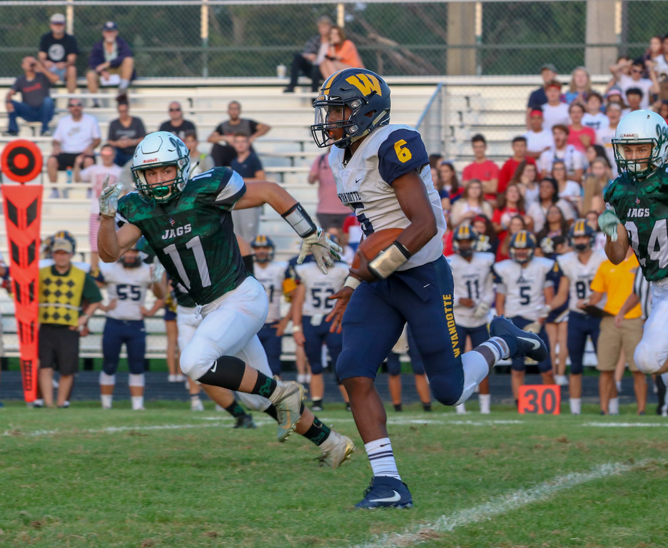 . Wyandotte Roosevelt quarterback Jalin Pitchford (6) takes off with the ball on Friday night, eyed closely by Nico Tiberia (11) of host Allen Park. The Bears went on to suffer a 30-14 defeat against the Jaguars. Jack VanAssche - For Digital First Media