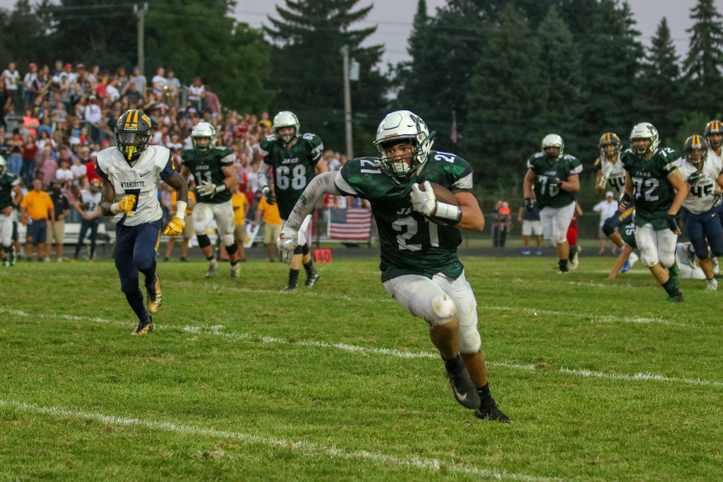 . Allen Park\'s Blake Gilliam races down the field on Friday night during his team\'s showdown with Wyandotte Roosevelt. Gilliam and the Jaguars went on to defeat the Bears by a score of 30-14. Jack VanAssche - For Digital First Media