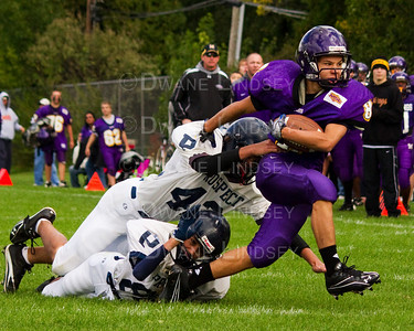 "Determined<br /> <br /> -Top 7 Finalist in Canon's ""Why Do You Love Football?"" national photo contest for 2010!   <br /> <br /> -Finished 2nd place in the Adult ""Action"" Category!"
