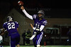 Quarterback Jack Milas (11) of Rolling Meadows throws a pass.