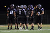 Quarterback Jack Milas (11) of Rolling Meadows has a discussion with his lineman during a timeout.
