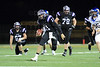 Quarterback Jack Milas (11) of Rolling Meadows runs downfield on a keeper.