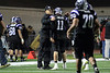 Quarterback Jack Milas (11) of Rolling Meadows and head coach Matt Mishler celebrate after a touchdown.