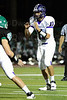 Jack Milas (11) of Rolling Meadows prepares to receive the snap.