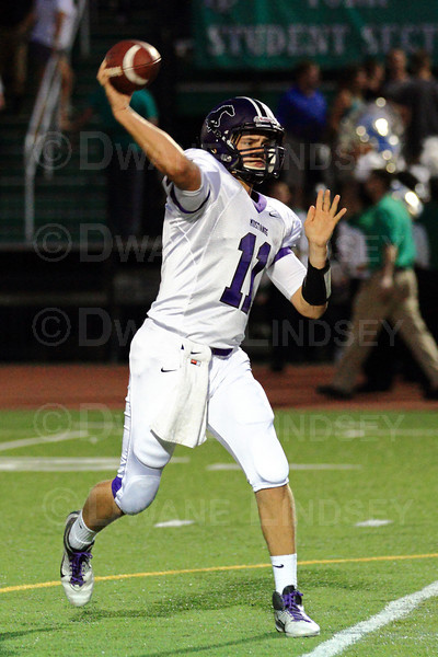 Jack Milas (11) of Rolling Meadows warms up before the game.