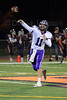 Quarterback Jack Milas (11) of Rolling Meadows throws a pass during warmups.