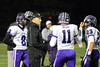 Quarterback Jack Milas (11) of Rolling Meadows discusses the plays with head coach Matt Mishler.