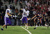 Quarterback Jack Milas (11) of Rolling Meadows throws a pass to running back Steven Royster (22).