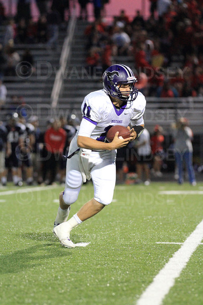Quarterback Jack Milas (11) of Rolling Meadows takes off on a QB keeper.