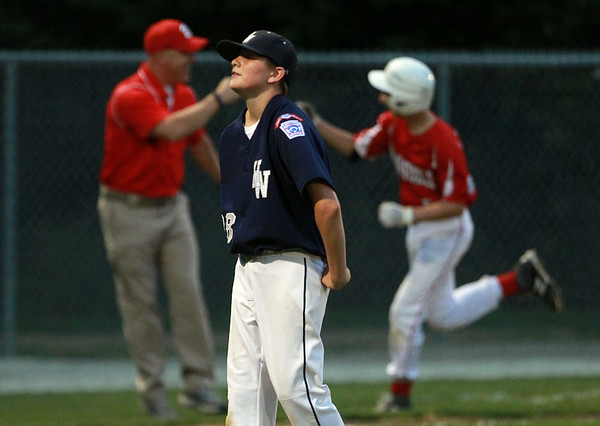 Hamilton-Wenham relief pitcher Will Jones slowly walks off the mound as Barnstable's Wyatt Scotti rounds third base with a walk-off home run. The Generals lost to Barnstable 12-1 in a shortened 4 inning contest on Friday evening at Harry Ball Field in Beverly. DAVID LE/Staff photo. 7/25/14.