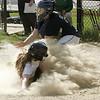 KEN YUSZKUS/Staff photo.  Hamilton-Wenham's Cate Pasquarello slides into home plate safely as the Essex Tech catcher Allie Sholds tries to tag her at the Essex Tech at Hamilton-Wenham softball game.   5/18/15