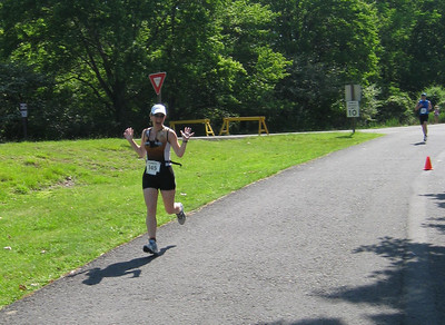 Sarah with a strong finish in her first triathlon!  And such a cute little mascot as well :-)