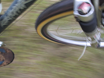 """Unintentional Action Shot"" Here's what can happen when the photojournalist/biker carries the camera in his hand while riding - presto! a shot of my toe and front wheel - cool!"