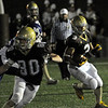 CARL RUSSO/Staff photo. Haverhill defeated Methuen 41-20 in Friday night football action. Haverhill's Chance Brady (3) cuts the corner for more yardage as his teammate, John Ramsdell (80) prepares to block for him. Brady scored five touchdowns in the game. 10/26/2012.