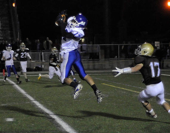 CARL RUSSO/Staff photo. Haverhill defeated Methuen 41-20 in Friday night football action.  Methuen's Colin Langford makes the catch just over the line for Methuen's first touchdown of the game. 10/26/2012.