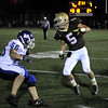 CARL RUSSO/Staff photo. Haverhill defeated Methuen 41-20 in Friday night football action. Haverhill's Shain Roche (5) looks to avoid being  tackled by Methuen's Nick D'Avolio (56) as he looks for running room. 10/26/2012.