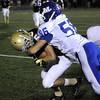 CARL RUSSO/Staff photo. Haverhill defeated Methuen 41-20 in Friday night football action. Haverhill's Shain Roche (5) is tackled by Methuen's Nick D'Avolio. 10/26/2012.