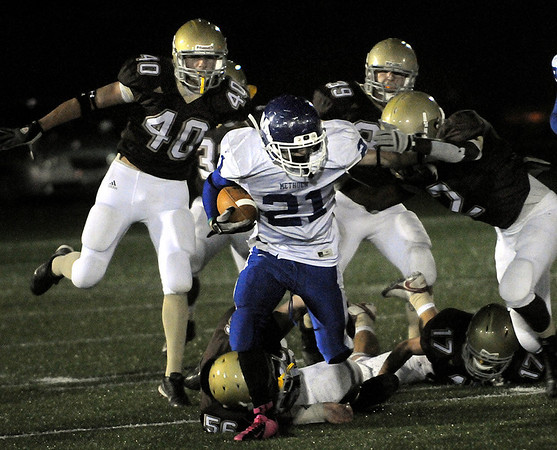 CARL RUSSO/Staff photo. Haverhill defeated Methuen 41-20 in Friday night football action.  Methuen's William Weinhold (21) breaks away for some yardage before Haverhill defenders take him down. 10/26/2012.