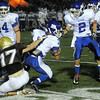 CARL RUSSO/Staff photo. Haverhill defeated Methuen 41-20 in Friday night football action. Haverhill's Tommy Maguire (17) holds onto Methuen's Ruddy Severino to make the tackle. 10/26/2012.