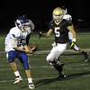 CARL RUSSO/Staff photo. Haverhill defeated Methuen 41-20 in Friday night football action. Methuen's Austin George-Williams (left) intercepts the Haverhill pass. 10/26/2012.