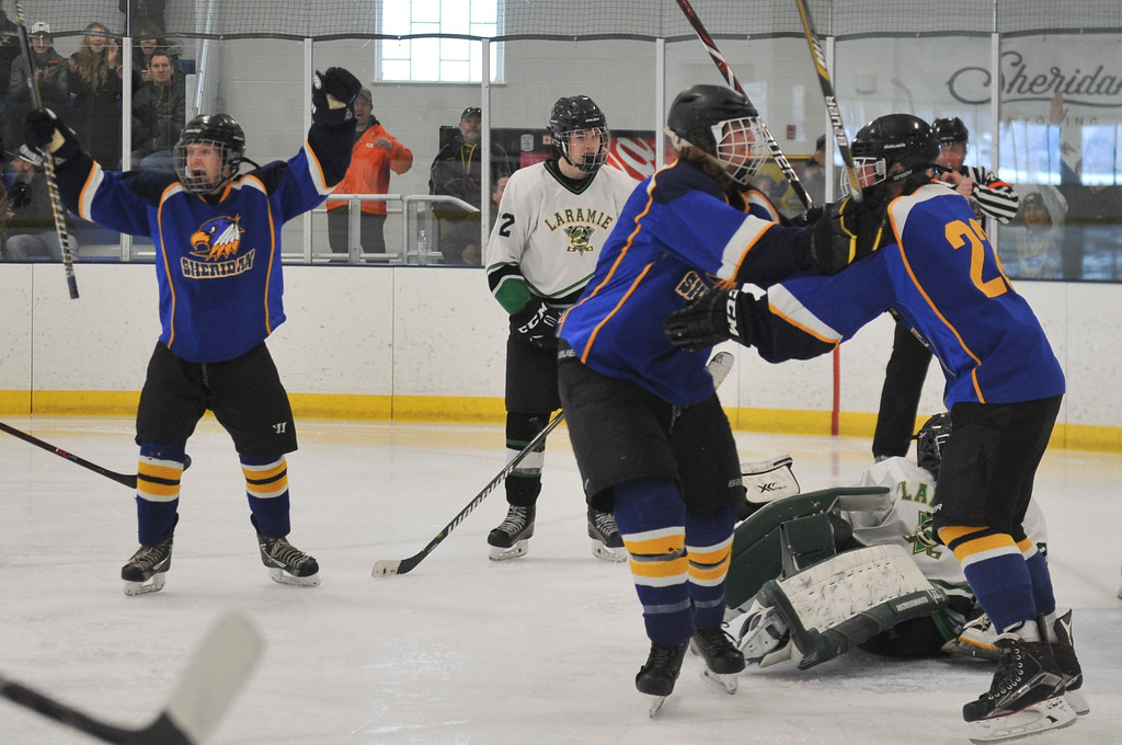 Justin Sheely   The Sheridan Press<br /> Sheridan Hawks celebrate a goal by Winfield Lommis (22) against Laramie during the WAHL High School B State Championship at Whitney Ice Rink in the M&M's Center Sunday, Feb. 25, 2018. The Hawks beat Laramie 4-3 to claim their first state title in 12 years.