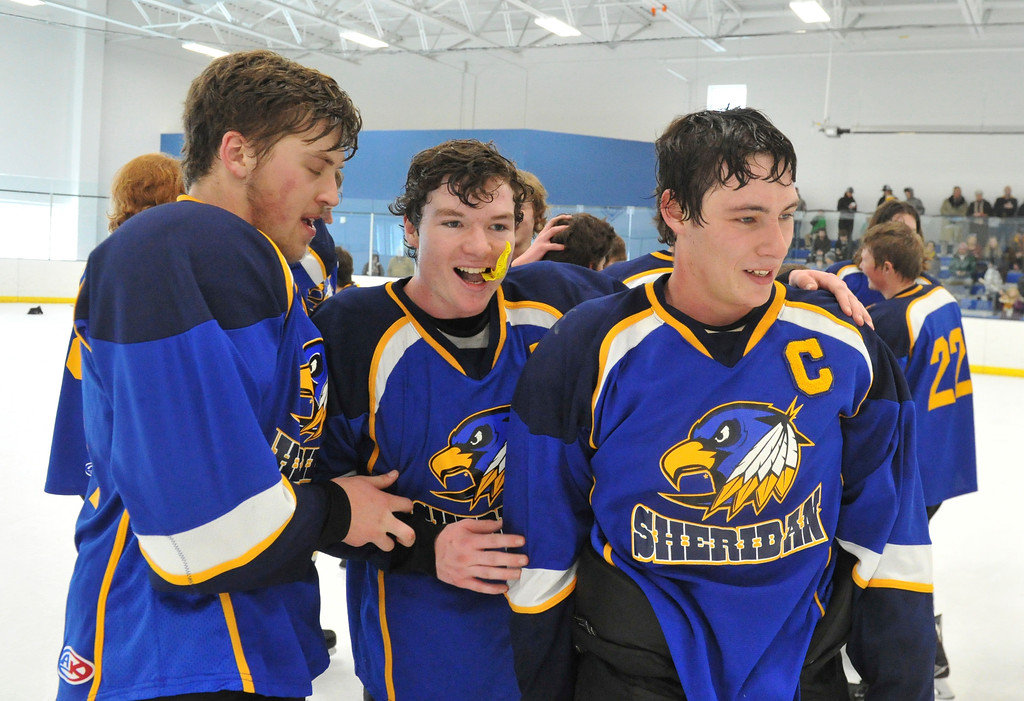 Justin Sheely   The Sheridan Press<br /> Sheridan's John Chase, left, Toby Jacobs and Samuel Boyles, right, celebrate after beating Laramie during the WAHL High School B State Championship at Whitney Ice Rink in the M&M's Center Sunday, Feb. 25, 2018. The Hawks beat Laramie 4-3 to claim their first state title in 12 years.
