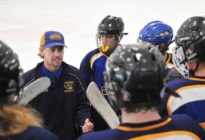 Justin Sheely | The Sheridan Press<br /> Sheridan's head coach Kirk Viren calls a timeout after Laramie scores in the second period 3-1 during the WAHL High School B State Championship at Whitney Ice Rink in the M&M's Center Sunday, Feb. 25, 2018. The Hawks beat Laramie 4-3 to claim their first state title in 12 years.