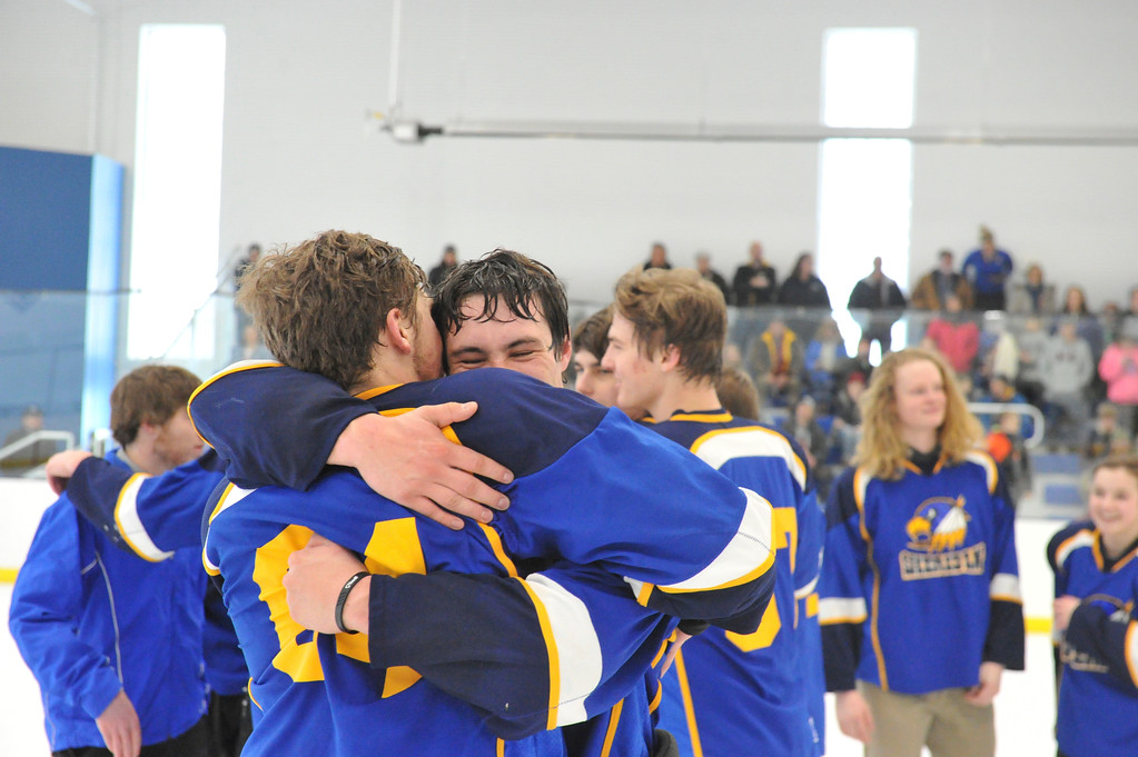 Justin Sheely   The Sheridan Press<br /> Sheridan's John Chase and Samuel Boyles, facing, celebrate after beating Laramie during the WAHL High School B State Championship at Whitney Ice Rink in the M&M's Center Sunday, Feb. 25, 2018. The Hawks beat Laramie 4-3 to claim their first state title in 12 years.