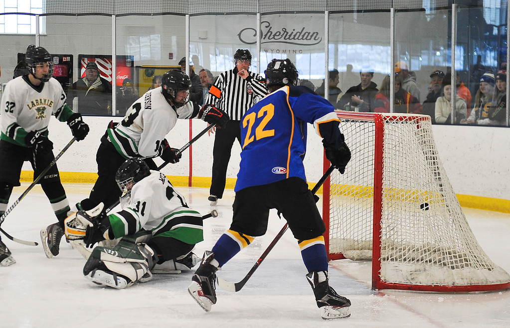 Justin Sheely   The Sheridan Press<br /> Sheridan's Winfield Lommis (22) scores against Laramie during the WAHL High School B State Championship at Whitney Ice Rink in the M&M's Center Sunday, Feb. 25, 2018. The Hawks beat Laramie 4-3 to claim their first state title in 12 years.